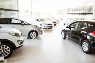 View of row new car at car dealership.jpeg